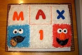 sheet cake with elmo and cookie monster made from dyed coconut