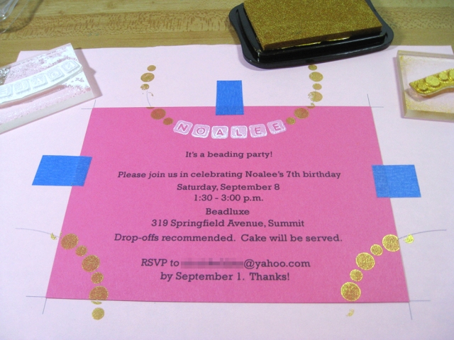 picture of invitation with rubber stamps applied to create gold round beads and white alphabet beads.