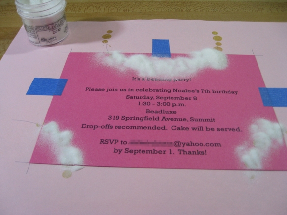 photo of invitation covered with clear embossing powder