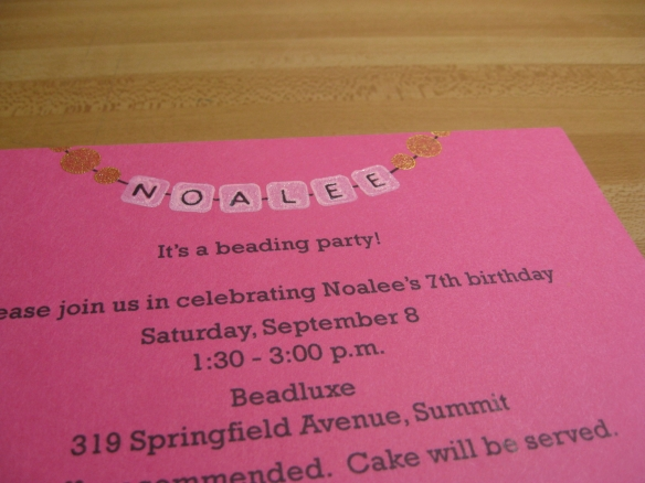 Close photo of invitation that shows glossy heat-embossed effect
