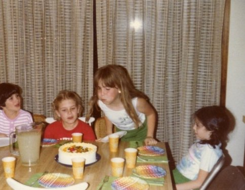 Four girls at a birthday party in 1979.