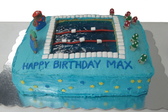 Super Mario decorated sheet cake with Jell-o swimming pool in middle