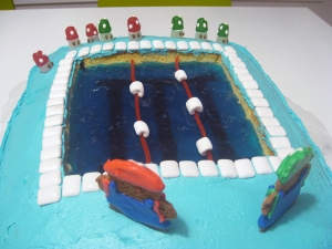 "Close up of a Jell-o ""pool"" inset into a vanilla sheet cake."